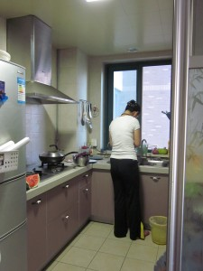 This is Mara's kitchen - this is a typical apartment in China for young couples - it is about 900 square feet and has 2 bedrooms, a bathroom with washing machine, a kitchen and a little great room with a balcony