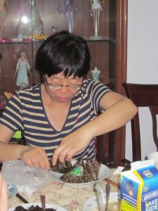 Jing preparing a special Hangzhou treat for us at her apartment